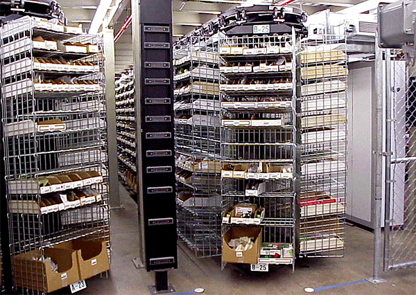 Horizontal carousels at Falcon Jet for parts picking.