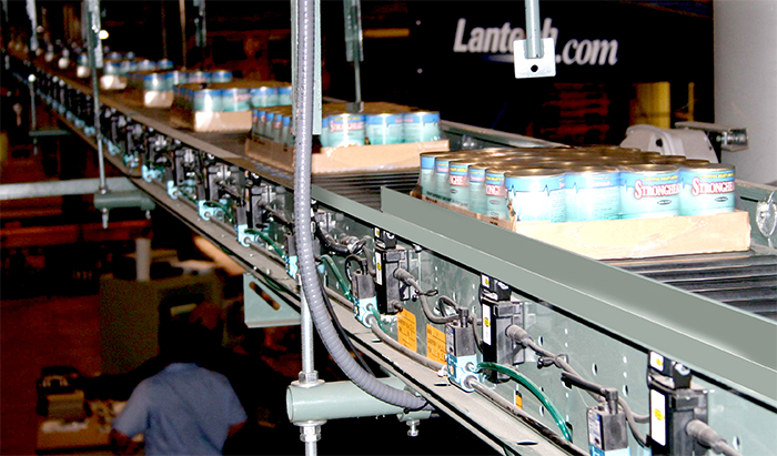 Overhead accumulation conveyor system for cases of dog food.